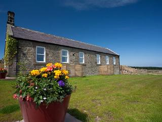 Outlook - a cosy cottage with castle and coastal views