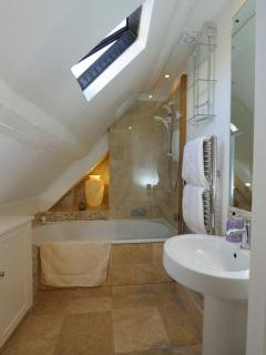 Upstairs bathroom with shower and jacuzzi bath