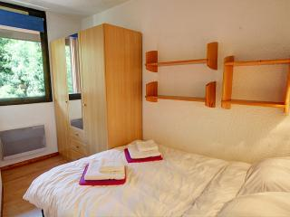 A double bed and a three door wardrobe