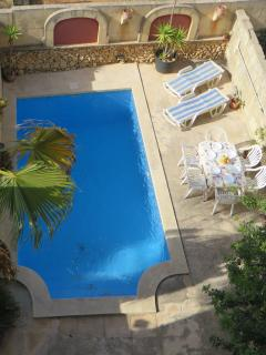 pool and deck area with ample space for sunbeds and BBQ area