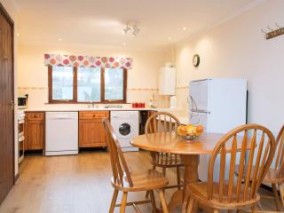 The kitchen/diner seats up to 6 and has dishwasher, washer, oven, microwave and fridge/freezer