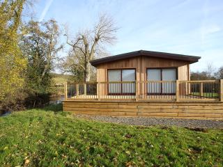 Front of lodge with decking.