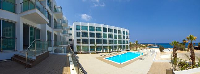 Panoramic view of apartments and pool