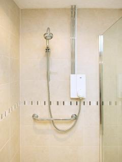 The newly fitted fully-accessible wet room has a roll-in power shower