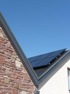 Solar PV and thermal panels provide power and hot water