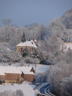Looking towards the village church on a snowy day