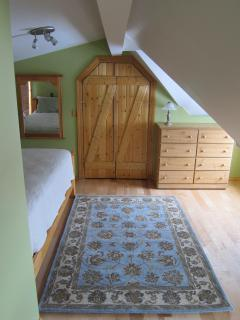 Entrance to master bedroom with walk-in closet and dresser