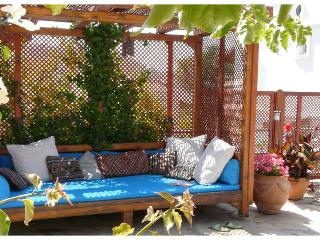Shaded Ottoman seating by the pool.