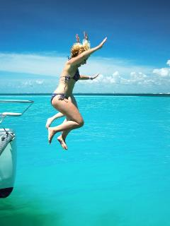 We higly suggest catamaran rides, this is our Sachie jumping from Raiatea's deck