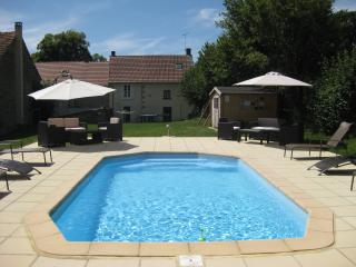Pool area with relaxing sun-loungers and amazing views, ideal for cooling off on hot sunny days.