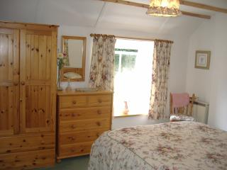 Quaint double bedroom with the sun streaming in at Crumplehorn Cottage No2
