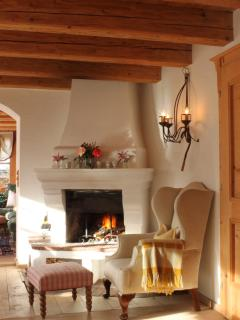 Dining Room Fire Place with Armchair. Perfect Relaxation after skiing.