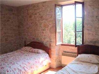 One of the sunny bedrooms
