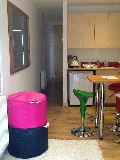 Kitchen area and bean bags.