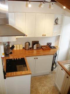 Kitchen which has dishwasher, washing machine and microwave