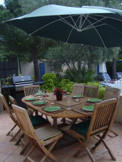 Dining on the back terrace overlooking the pool