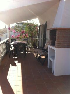 Shaded terrace, BBQ for al fresco dining with magnificent views of Lake Viñuela and Mount Maroma