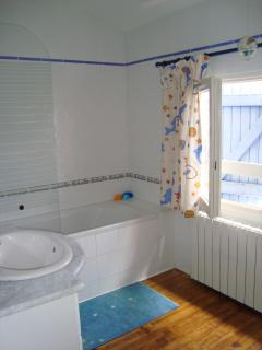 Upstairs bathroom with bath, shower and sink