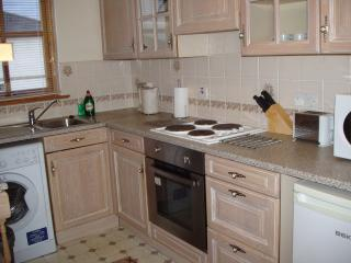 Fully fitted kitchen with microwave, oven, fridge, freezer, washing machine