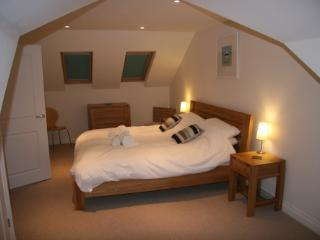 Upstairs super-king size bedroom with desk in front of dormer window (not seen)