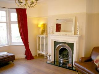 The sitting room is a great place to relax by the limestone fireplace