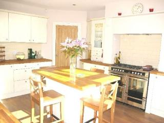 The fully equipped kitchen has everything you would expect in a home from home including a range.