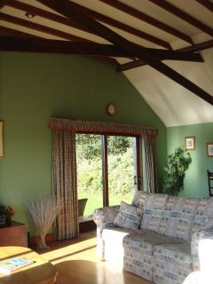 Oak beamed ceiling / lounge.