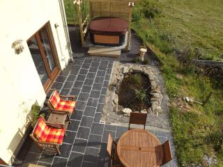 The slate patio with furniture and hot tub for your relaxation