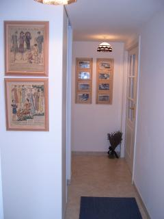 The entrance hall gives access to all rooms, and has a spacious hanging wardrobe.