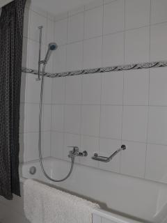bathroom has shower in bath