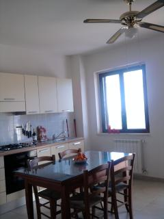 Kitchen area includes ample cutlery and cooking utensils for self catering