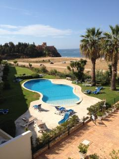 View across the pool towards the castle and beach.