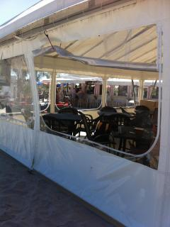 Enclosed tent with tables and chairs