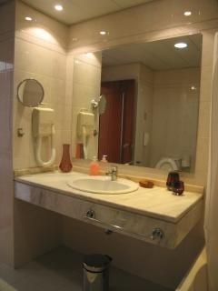 Bathroom with bathtub and hairdryer
