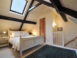 Magnificent double bedroom 2 with eaves beams
