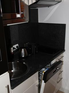 Kitchen with oven, hob, microwave and dishwasher