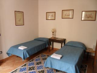 Room furnished with two single beds