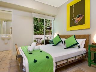 Comfortable and Queen size Bedroom 2 with an ensuite and private courtyard and air conditioning.
