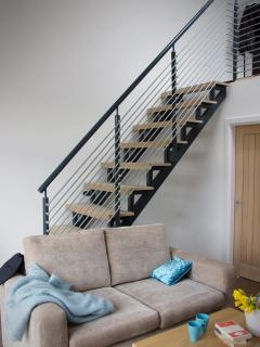 The stairs provide access to the contemporary bed deck, but there's a downstairs sofa bed