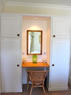 Dressing table with plenty of wardrobe and shelf space. There are fitted cupboards in all bedrooms.