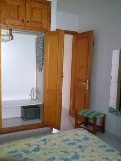from bedroom out; appreciate big wardrobe with safe, iron, ironing-table and plenty of hangers