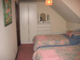 En suite bedroom - full bath with power shower over.