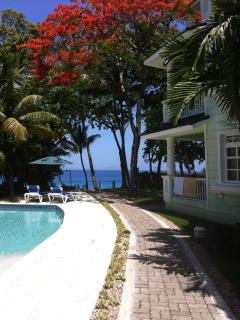The garden with swimming pools and the walkway to the beach