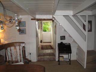 From dining area to hallway and stable door leading to patio