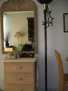 Dresser, mirror and floor lamp