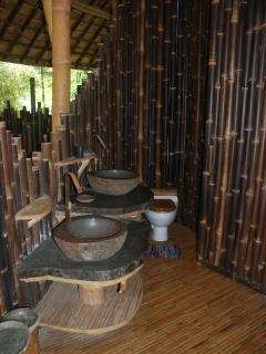 Second floor bathroom with stone washbasins