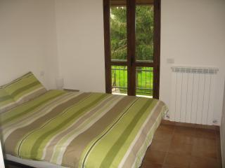 Main bedroom with access onto rear terrace