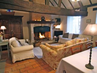 Le sejour (sitting room) with its roaring fire in winter