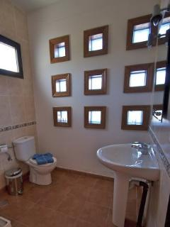 Ensuite to third bedroom. Shower, toilet, sink.