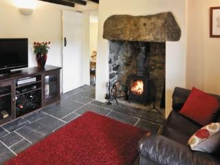Cosy, beamed sitting room with log burning stove